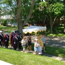 An estimated 100 parishioners participated in the Corpus Christi Procession after the 11 a.m. Mass. The Knights of Columbus 4th degree Honor Guard escorted the procession which included the choir members, bell ringers and  St Paul  faithful around the Block. It was a beautiful scene on a beautiful day.